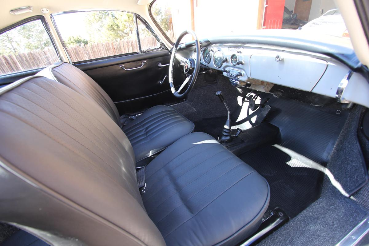 classic antique car with leather upholstery in driveway in santa fe, NM