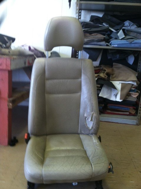 Torn car seat before leather reupholstery