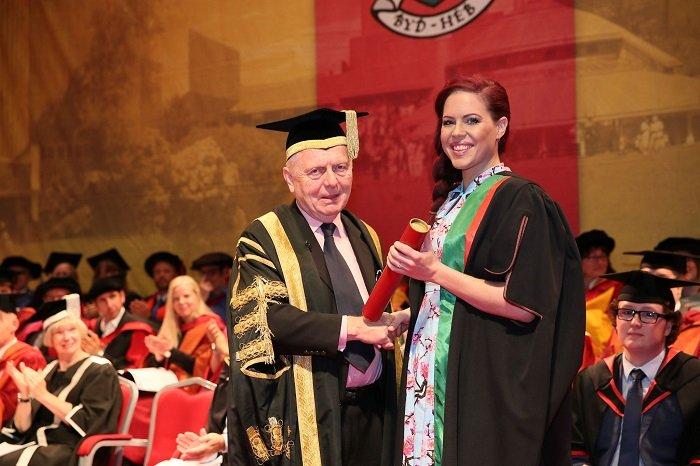 photo of Natasha Devon holding diploma