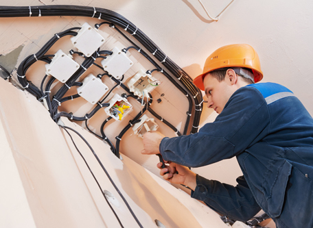 Electrician repairing wires