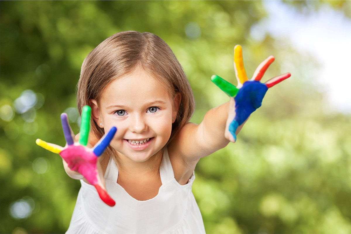 Little Girl with paint on hands