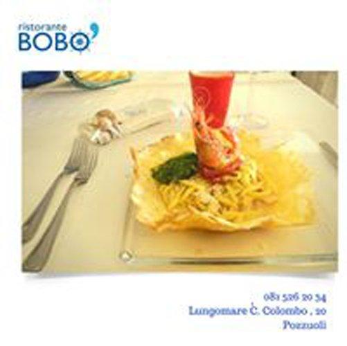 pubblicita del Ristorante BOBO con piatto di spaghetti  di pesce