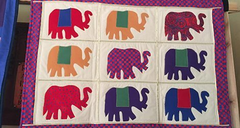 Quilts with elephant motifs