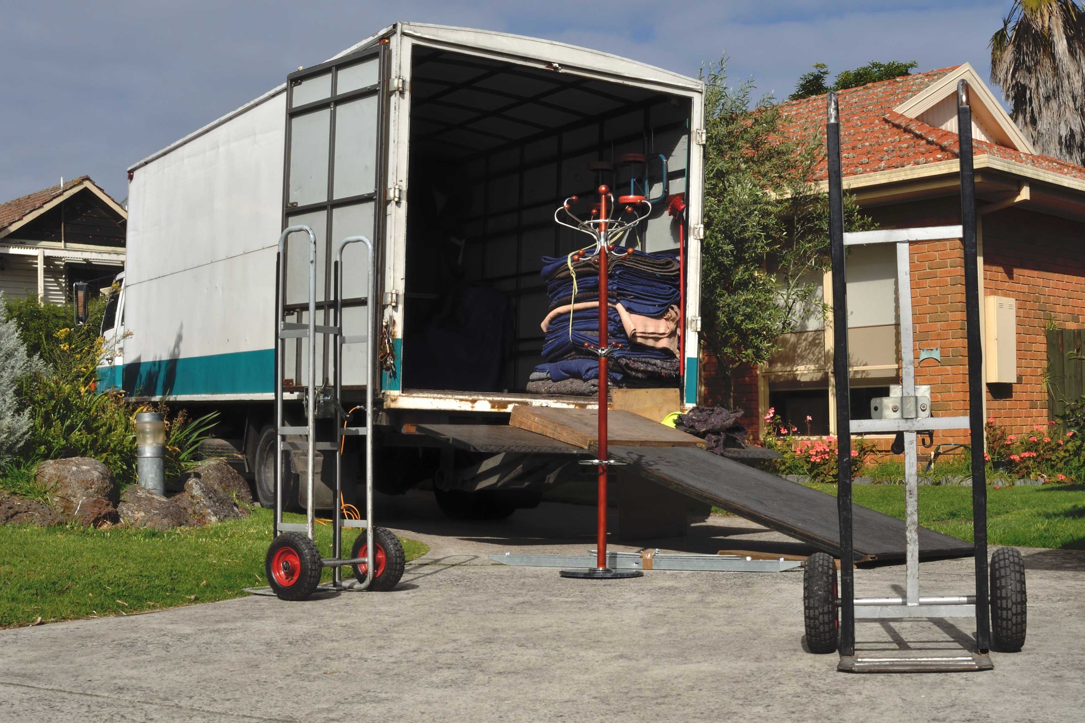 Moving truck loading household goods by movers team