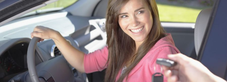 Young woman in car at driving school in Rochester, NY