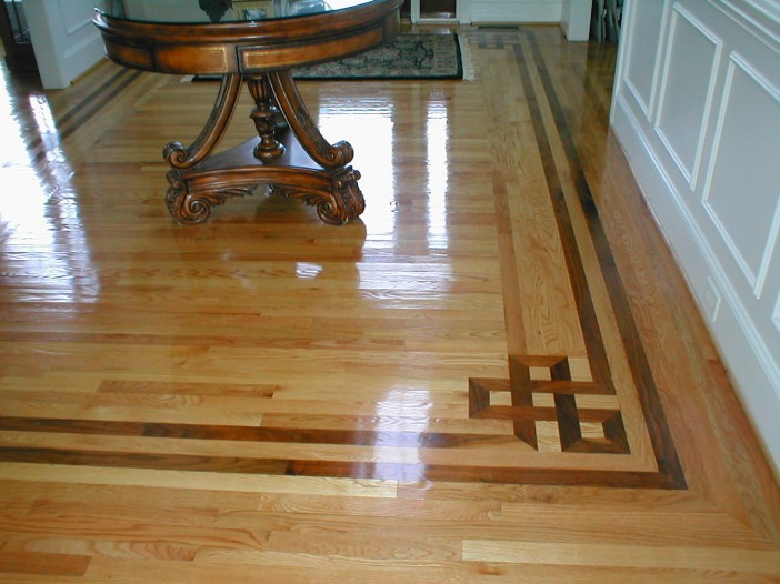 Custom hardwood floor inlays charlotte ballantyne nc for Hardwood floor designs