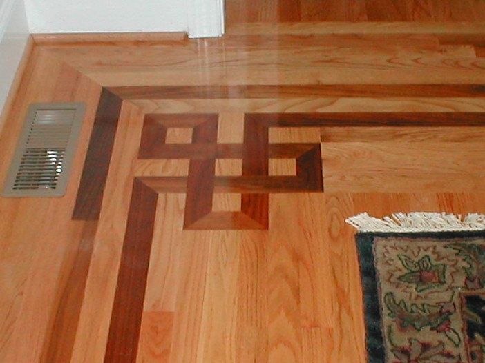 Custom hardwood floor inlays charlotte ballantyne nc Hardwood floor designs borders