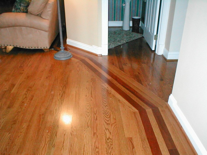 Custom hardwood floor inlays charlotte ballantyne nc for Custom hardwood flooring