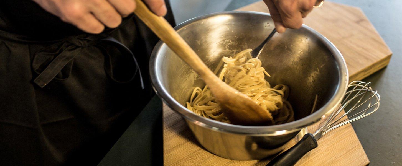 Chef tossing pasta