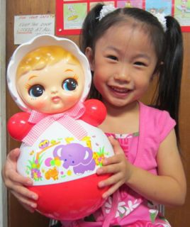 Girl with Roly Poly Dolls in Honolulu