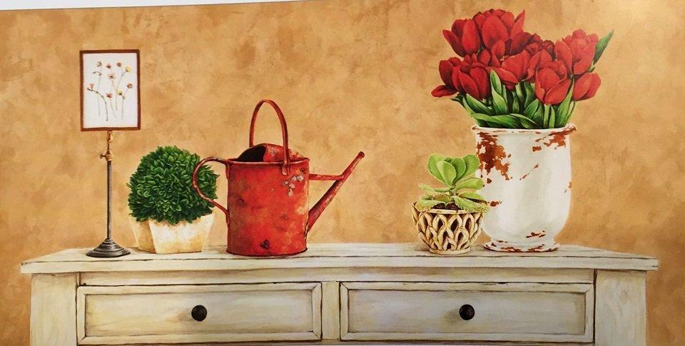 quandro che rappresenta un mobile con sopra un annaffiatoio, un vaso con fiori rossi e due piante verdi