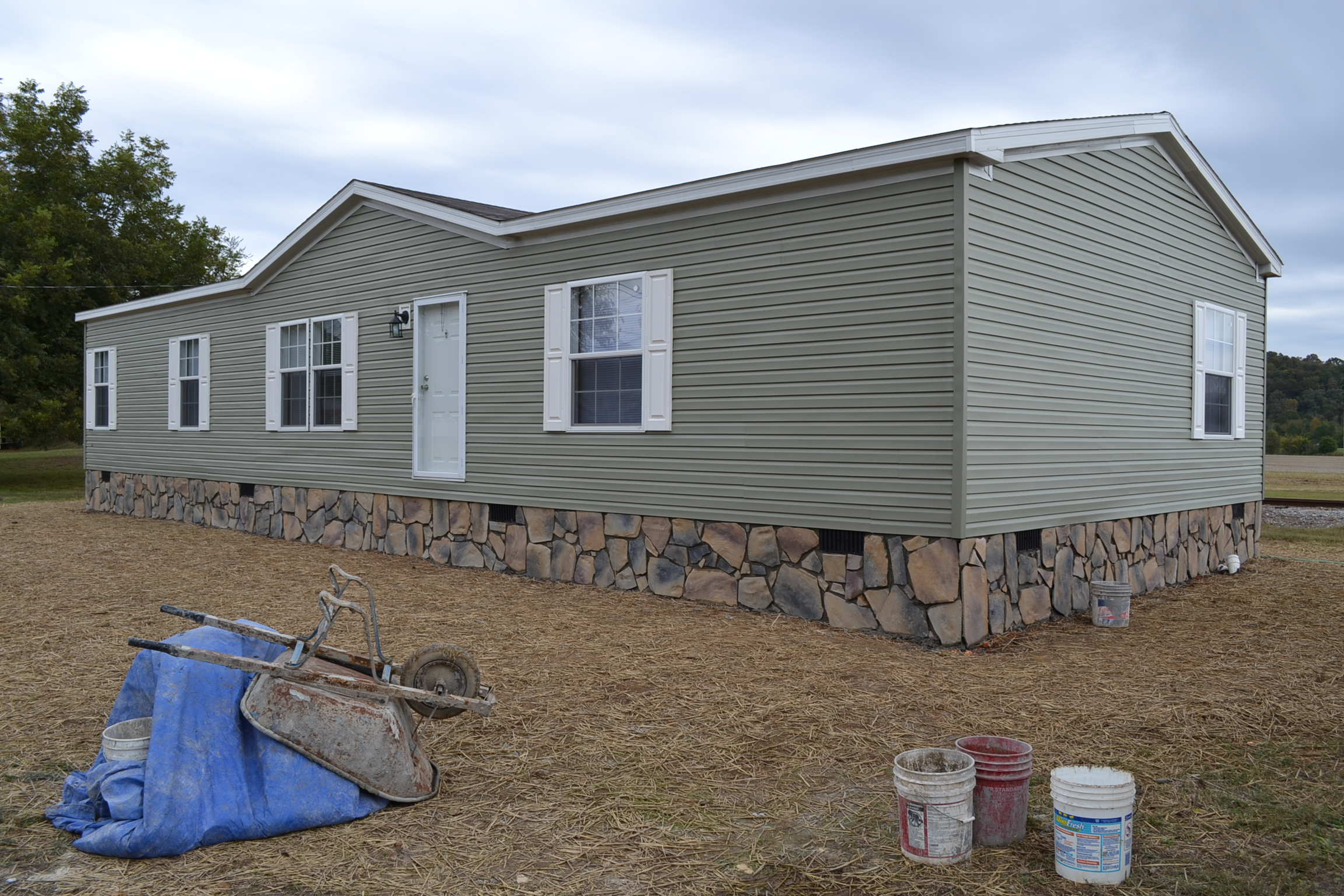 install skirting on a mobile home with Underpinning Stone on Skirt board moreover Watch as well Deck Skirting likewise Do You Want To Cover Concrete Foundations With Faux Brick Or Stone No Problem additionally 6908096047.
