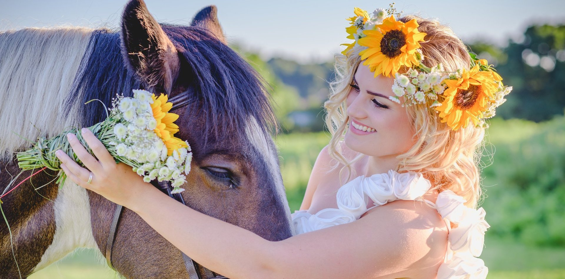 bride smiling next to a horse