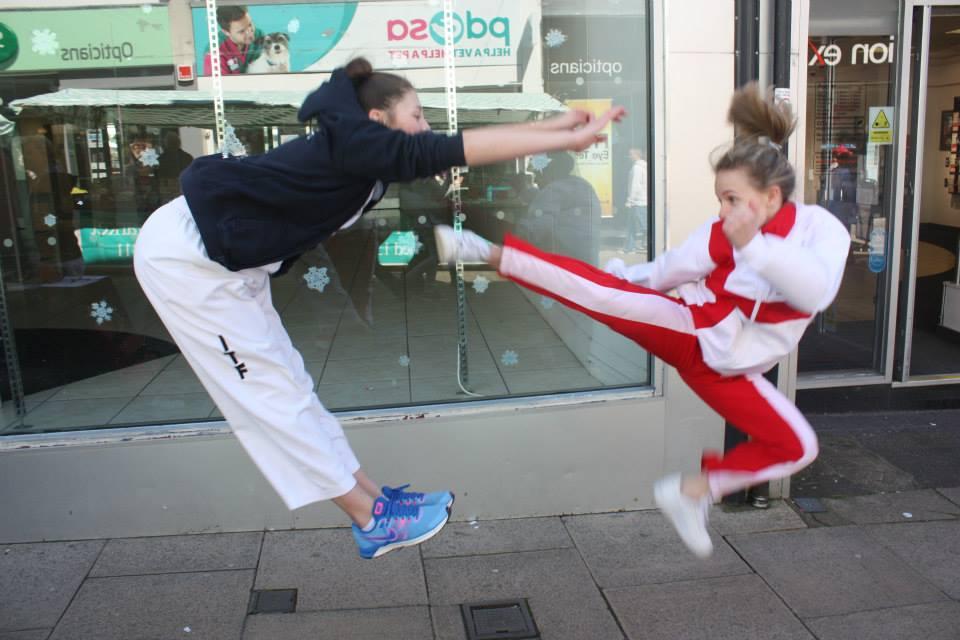 a lady practicing Taekwon-do