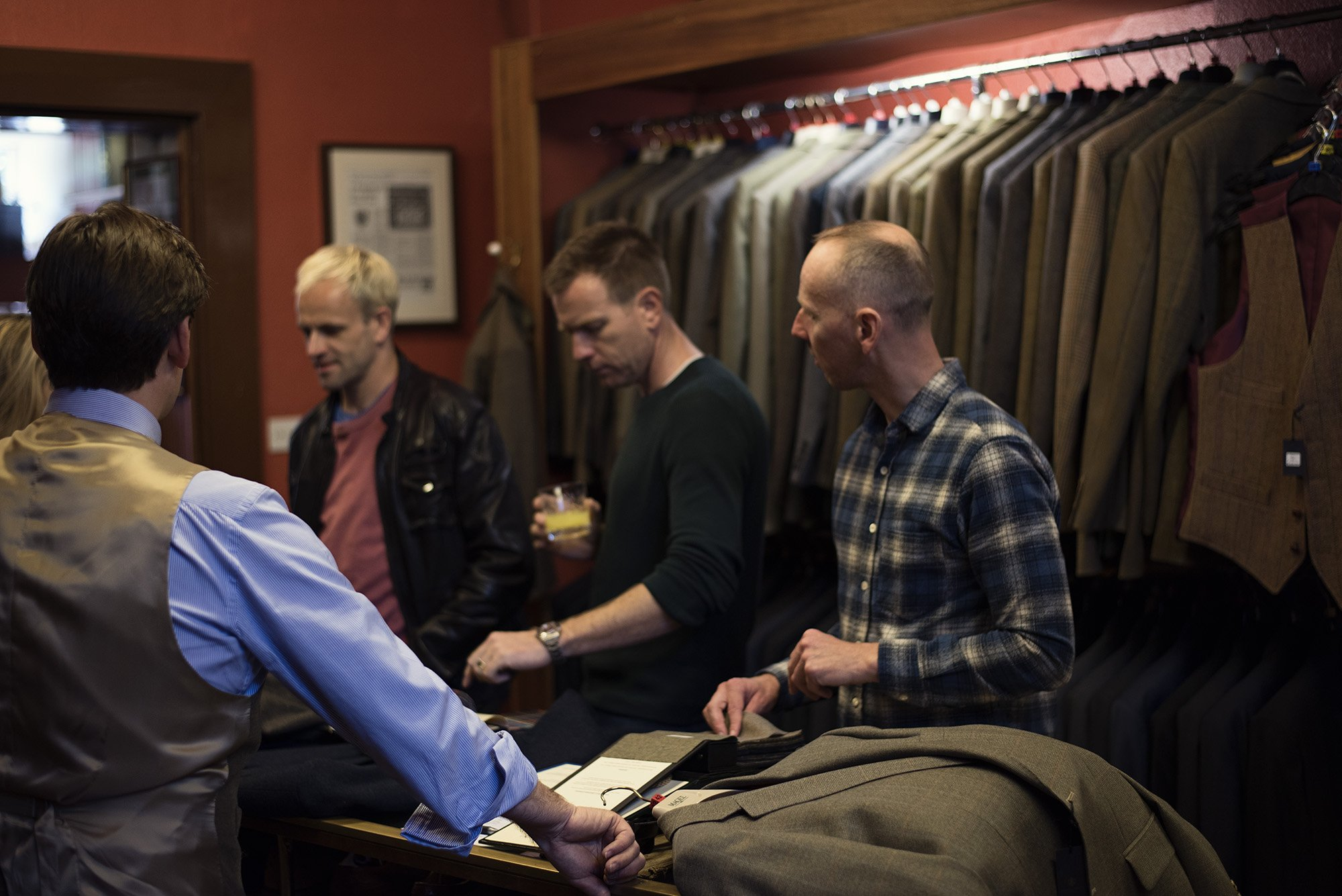 Ewen Bremner,   Ewan McGregor and Jonny Miller make choices of cloth for bespoke Stewart Christie & Co. suits.
