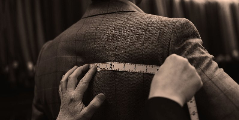 Bespoke history at Stewart Christie & Co. tailoring team measuring a customer