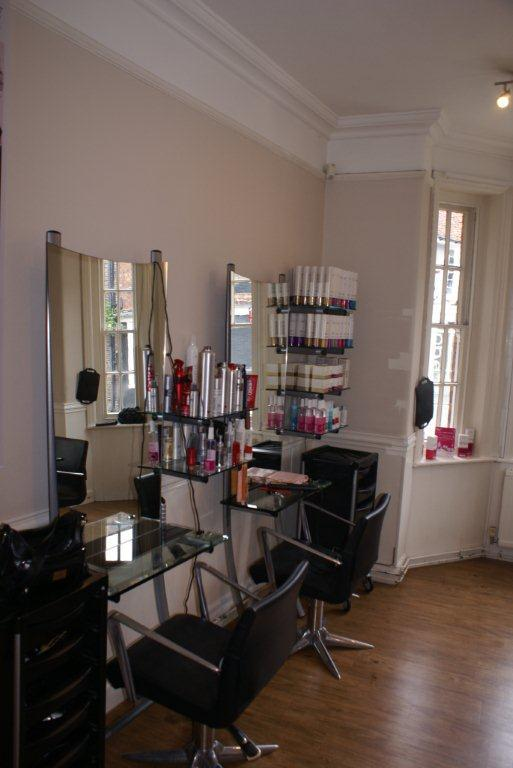 She;ves of brand name products in the salon