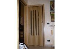 Porte pieghevoli in legno