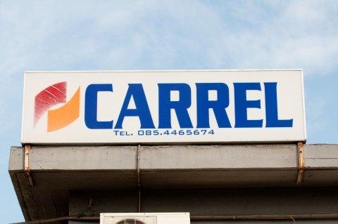 Insegna Carrel