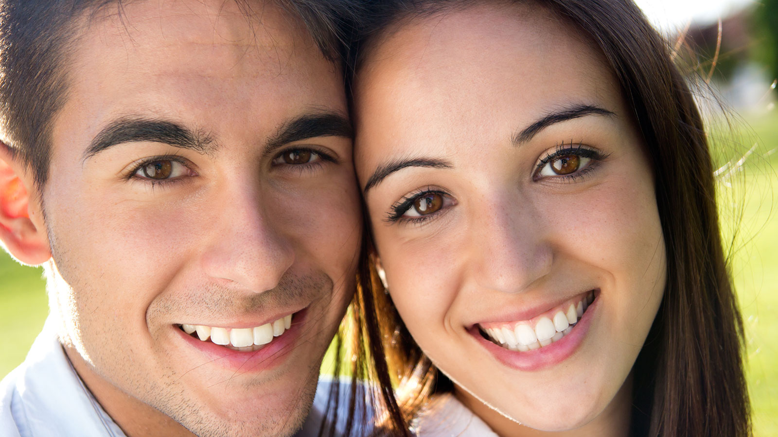 closeup view of a girl and a boy who are smiling