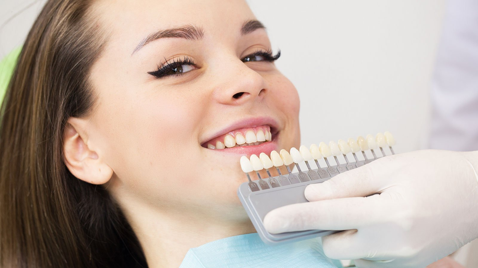 a woman smiling at the dentist