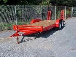 Red trailer with pull out ramps