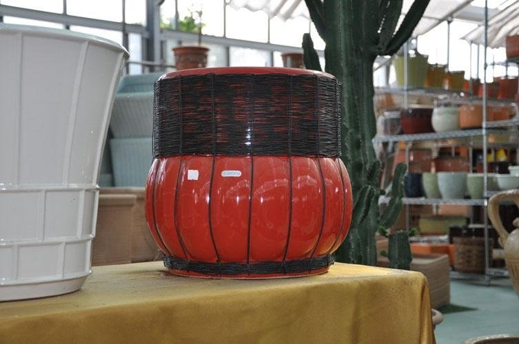 a red-coloured terracotta pot