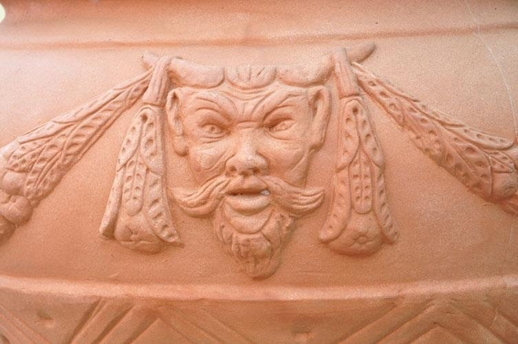 a design on a terracotta pot