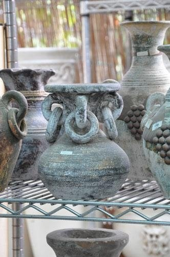 terracotta pots with rings and designs
