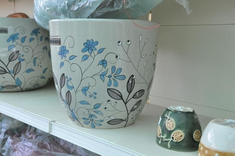 terracotta pots with drawings of plants on them