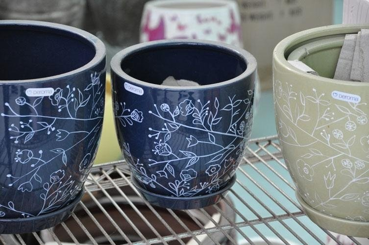 blue-coloured pots with white designs