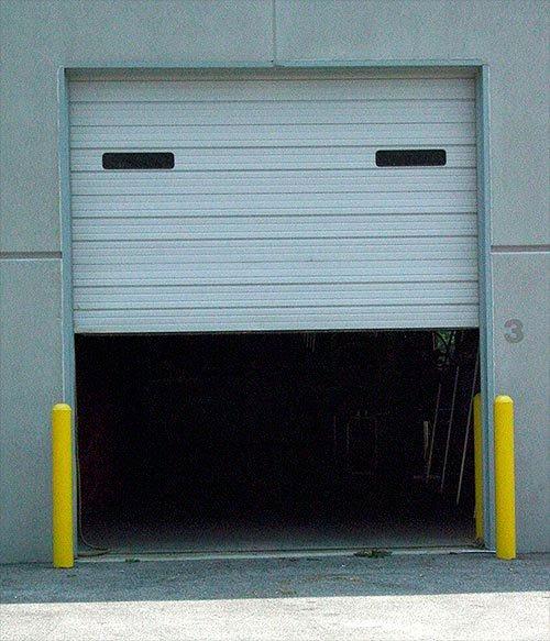 A door during maintenance for commercial garage doors in O'Fallon, MO