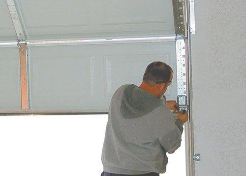 Man repairing a garage door