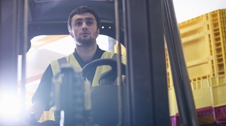 trainee practicing using forklift