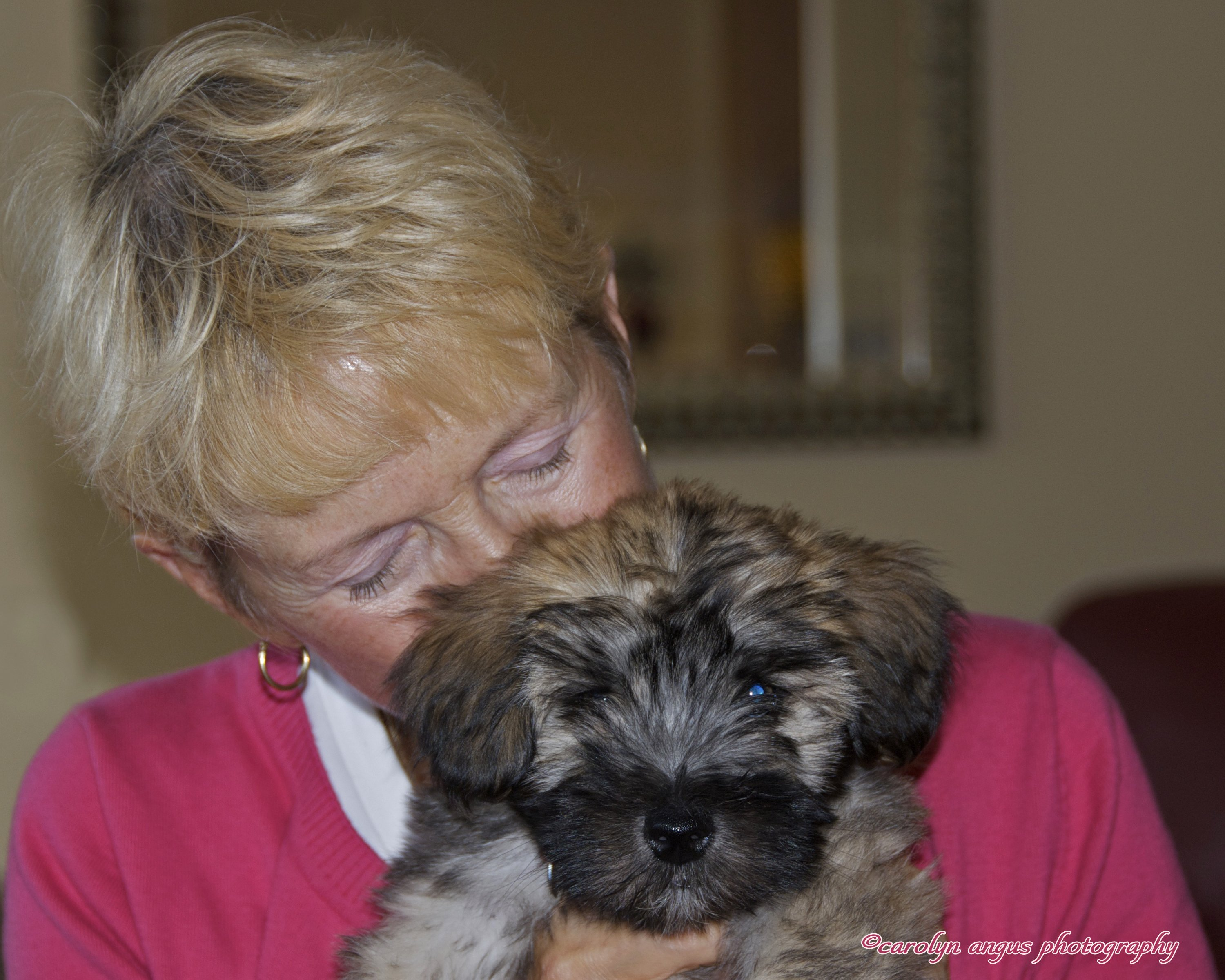 Veterinary employee embracing a puppy at the animal hospital in Port Coquitlam
