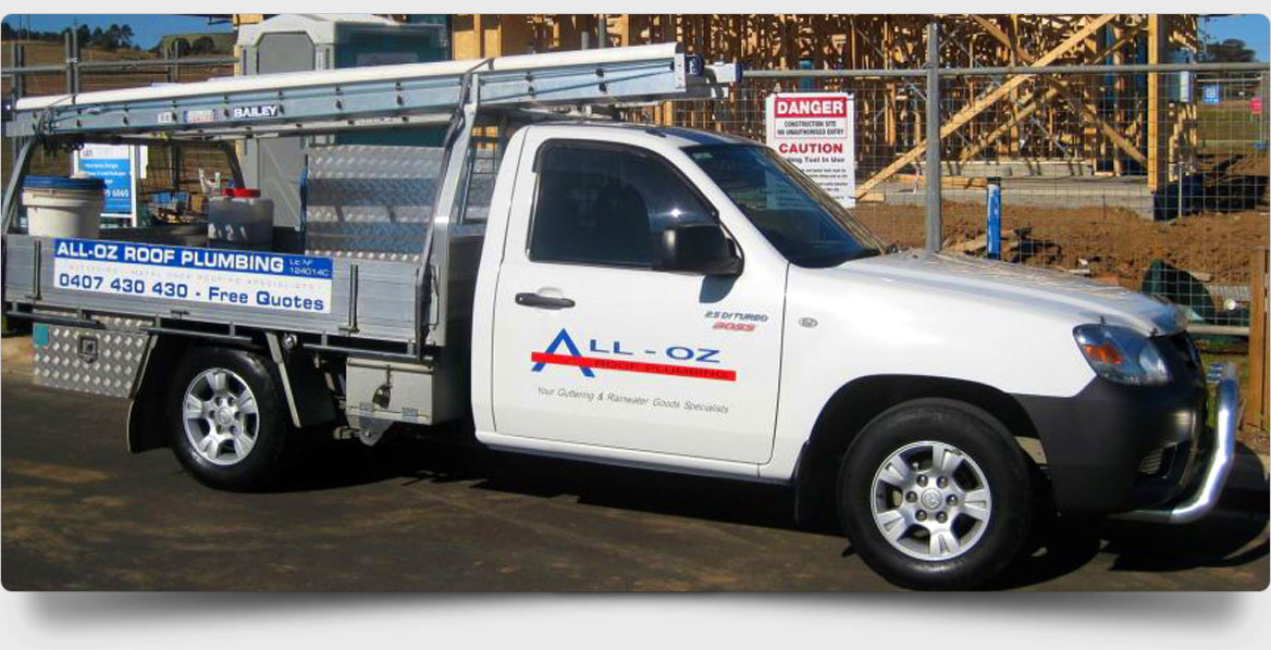 all oz roof plumbing truck with business logo