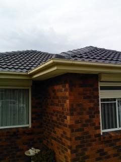 all oz roof plumbing brick house with roof gutter installed in the top