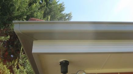 all oz roof plumbing grey roof gutter covering the edges