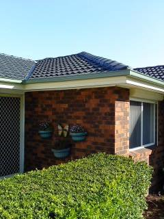 all oz roof plumbing light green gutter near roof top