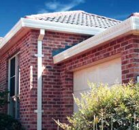 all oz roof plumbing roof gutter installed in new brick house