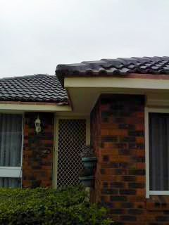 all oz roof plumbing side view of brick house without roof gutter