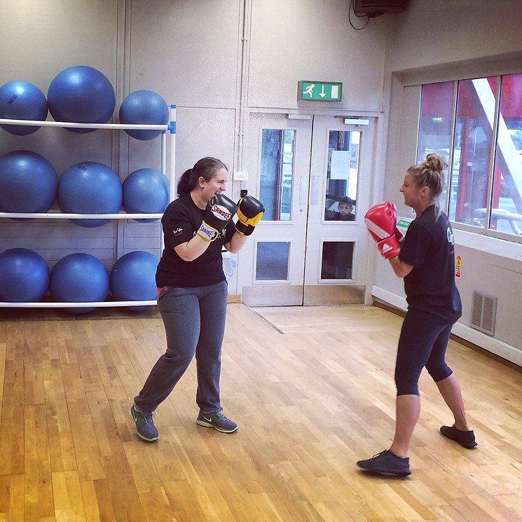 ladies practicing kickboxing