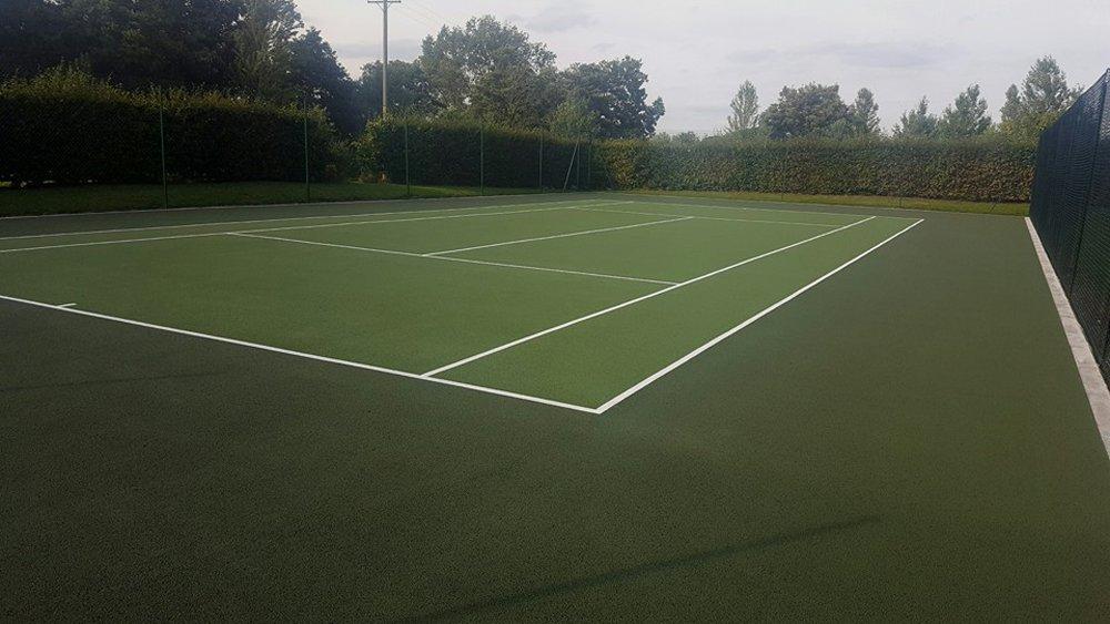 Tennis court turfing