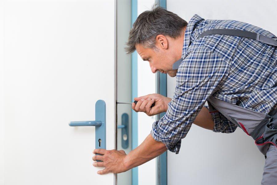 man working on lock