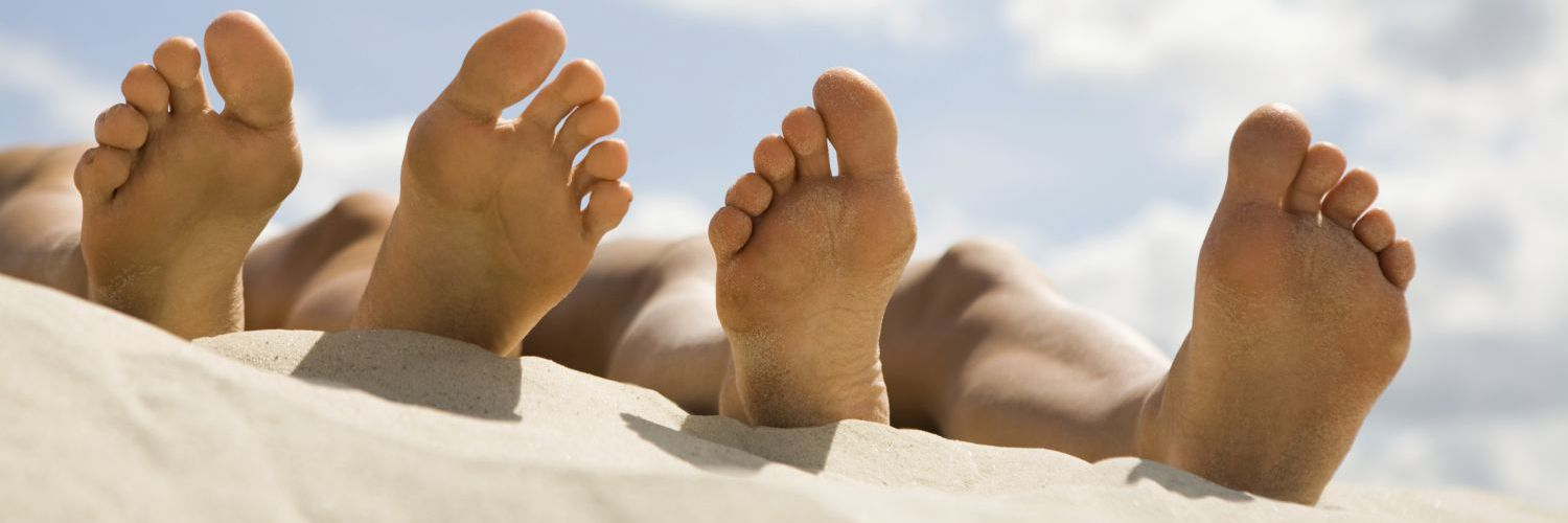 Healthy feet on the beach - a result of regualr foot care in Russellville, AR