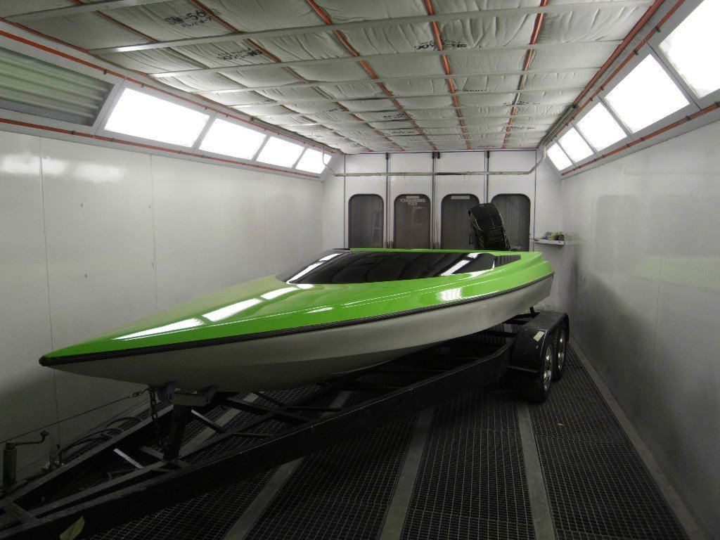 View of a paint booth with green boat