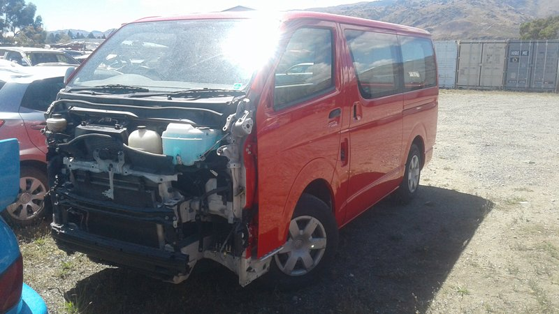 Collision repair work in progress on red van