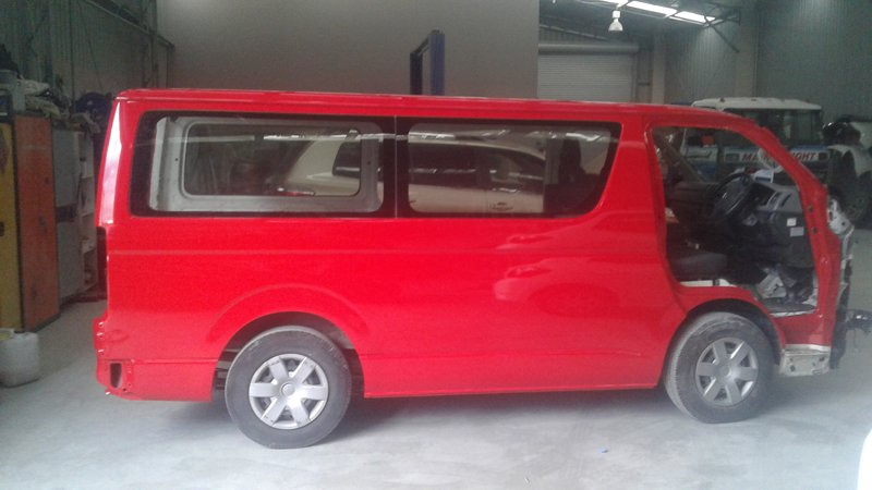 Side view of a red van