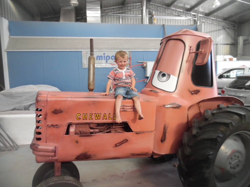 Young boy sitting on a tractor