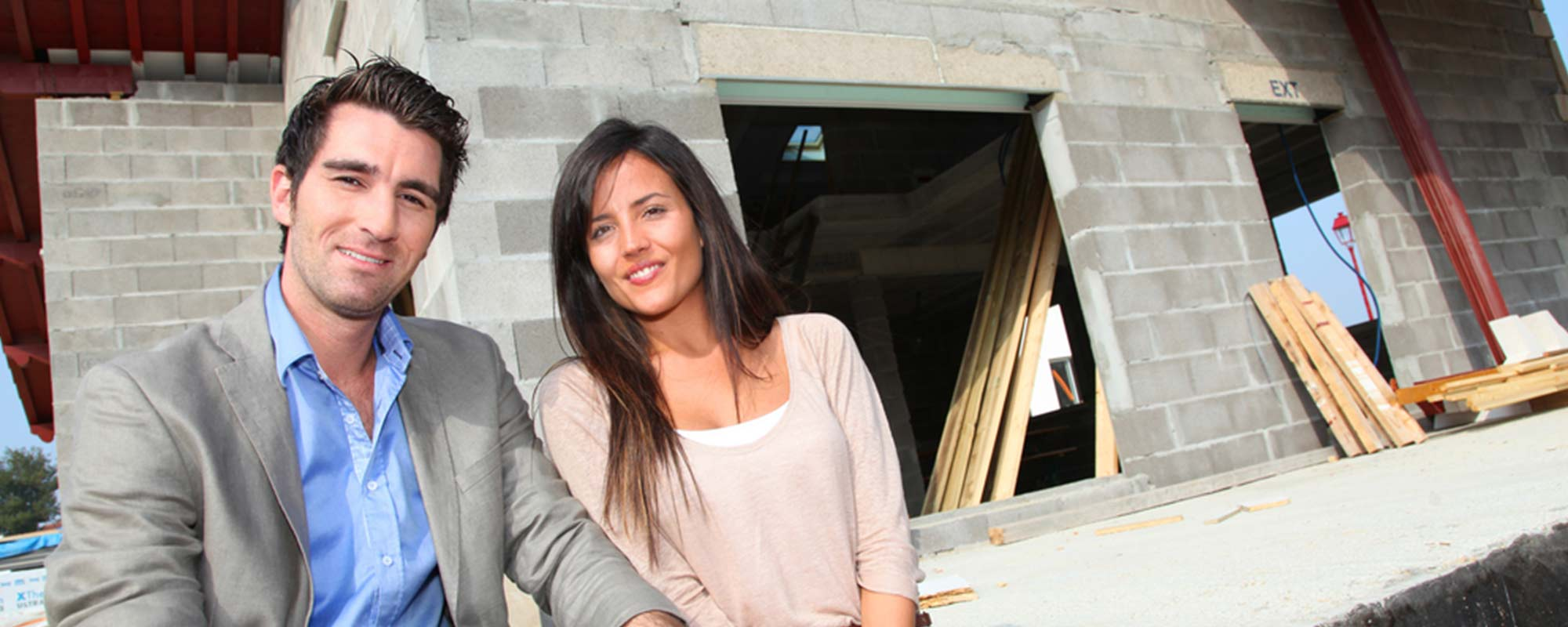 Couple standing at the construction site